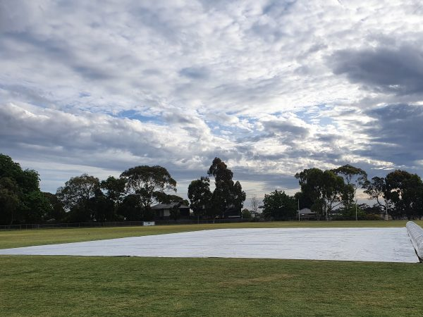 Inflatable cricket pitch cover fully put rolled out on the ground
