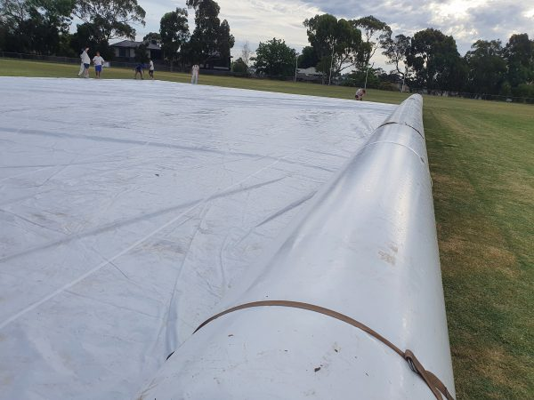 Inflatable Cricket pitch cover on the field