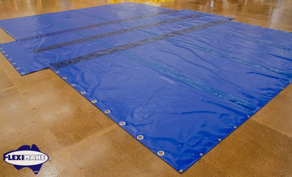 Blue container tarps with eyelets on the floor
